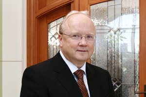 Charles Loewen (shown here in 2008) is back as an owner of the window company that bears his company's name.
