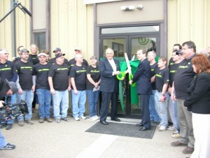 Serious president Kevin Surace (middle right), participates in a green ribbon cutting ceremony with PA Governor Ed Rendell (middle left) along with rehired Kensington employees.