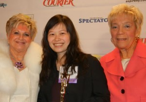 Isabella Leung (center), receives Rising Star Award from Queens Courier founder and publisher Vicki Schneps (left) and Queen Borough President Helen Marshall.