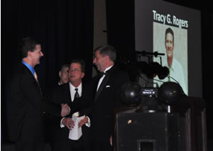 Tracy Rogers accepts his marketing award from Rich Walker, AAMA president, and Brent Slaton, last year's winner.