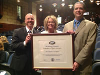 "From left: Hurd president/CEO Dominic Truniger, Hurd director of marketing April Lucas and Hurd director of international sales Scott Klieforth accept the President's ""E"" Award for Exports."
