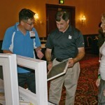 NWDA president Steve Chen (left) visits with Screenco during the tabletop exhibits.