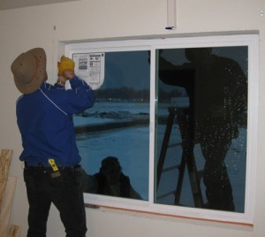 Installation of a triple-pane window in one of PNNL's Lab Homes.