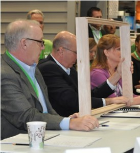 PlyGem judges (including president Gary Robinette on far left), listen to the innovative product presentations.