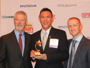 "Crystal Window & Door Systems' production manager Joseph Chang (center), with fellow ""Rising Star"" award winner actor Stephen Lang (left) and Queens Courier co-publisher Joshua Schneps (right)."
