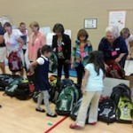 At the AAMA 2014 Fall Conference, attendees stuffed and donated 500 backpacks to a local Title I elementary school.