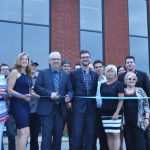 Groupe Eugenie president Richard Chauvette prepares to cut the ribbon at his company's new headquarters near Montreal.