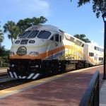 A SunRail train leaving a nearby train station.